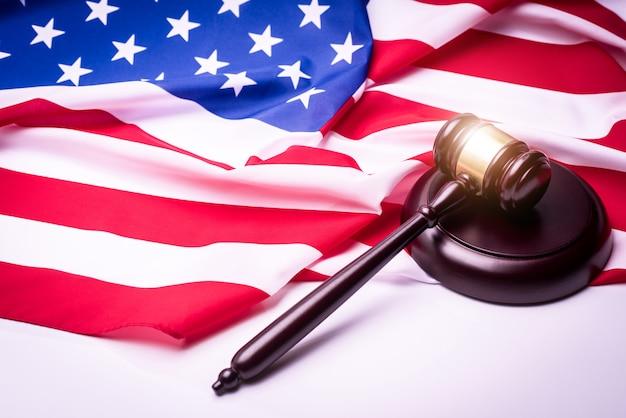 Law gavel and usa america flag - american crime concept.