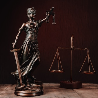 Law offices of lawyers legal statue greek blind goddess themis bronze metal statuette figurine with scales of justice. - image