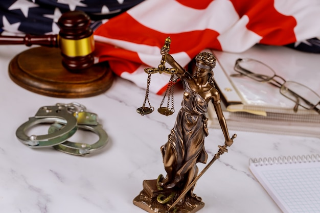 Law united states of america, statue of lady justice with file justice documents folder united states of america flag