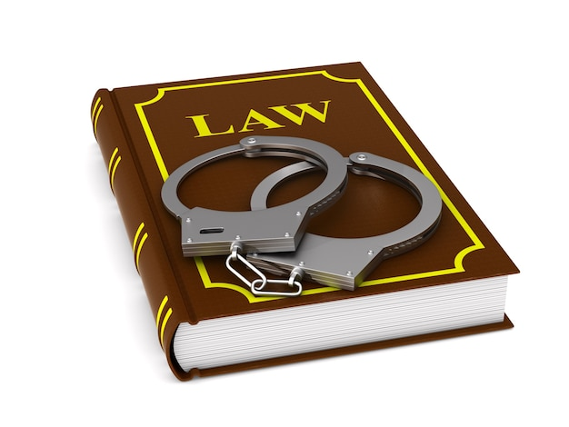 Lawbook and handcuffs. isolated, 3d rendering
