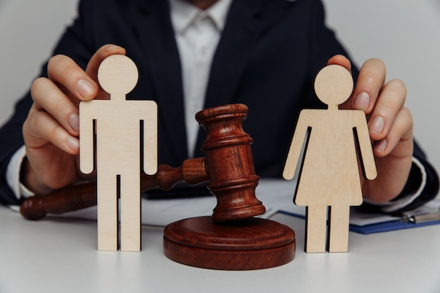 Lawyer or counselor holds figures of family.