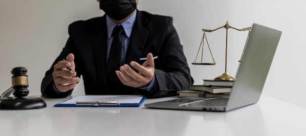 A lawyer explaining the details of the case and the law to his client as a way to fight the lawsuit, the client consulted a fraud attorney. concept of litigation consultation from legal experts.