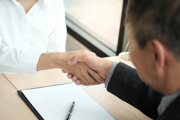Lawyer handshake with client. business partnership meeting successful concept.