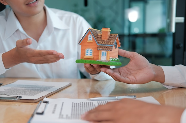 Lawyer insurance broker consulting giving legal advice to customer about buying renting house. financial advisor with mortgage loan investment contract. realtor selling real estate