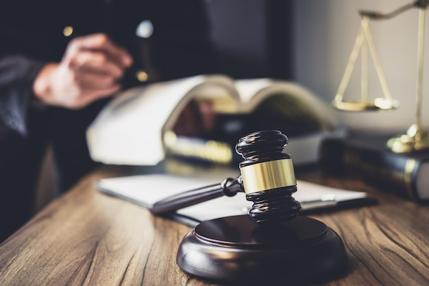 Lawyer or judge counselor working with agreement contract in courtroom