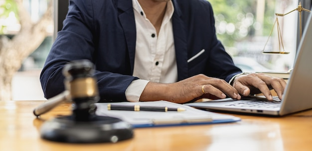 A lawyer man is seeking information on a fraud case to bring to court in a lawsuit from which a client has filed a lawsuit against an employee at a company that commits fraud. fraud litigation concept