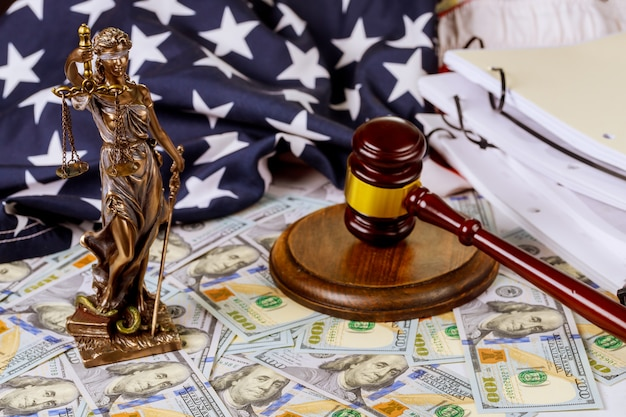 Lawyer office statue of justice with scales and gavel and money