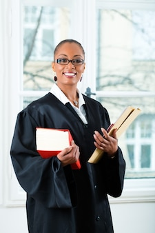 Lawyer in office with law book and dossier