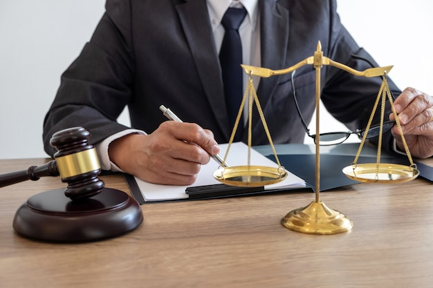 Lawyer working on a documents and report of the important case and wooden gavel