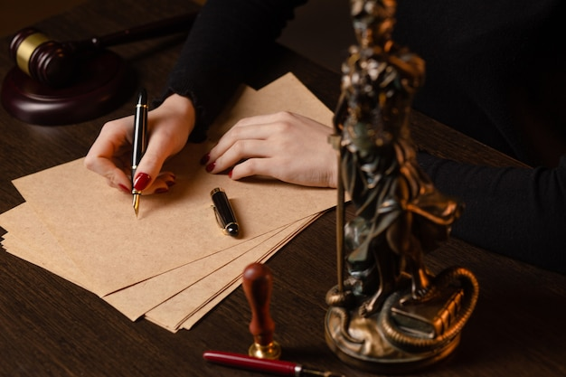 Lawyer working with contract papers and wooden gavel on tabel in courtroom justice and law attorney court judge