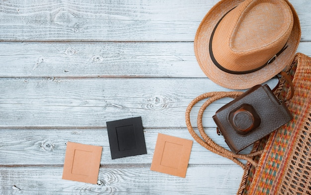 Lay flat white wooden background, vintage summer accessories, vintage film camera, save memories of summer. pictures in frames