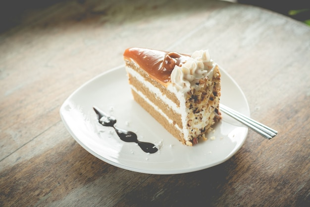 Layer cake with coffee flavor and caramel syrup in cafe(vintafe color)