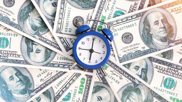 A layer of money with clock in the center. finance idea