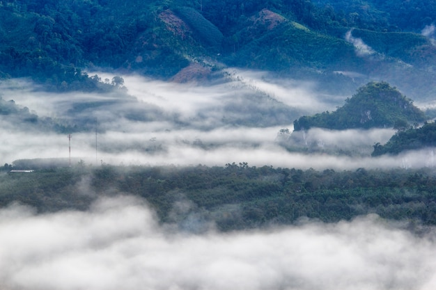 Layer of mountains in the mist at sunrise time, baan nai wong, ranong province, thailand