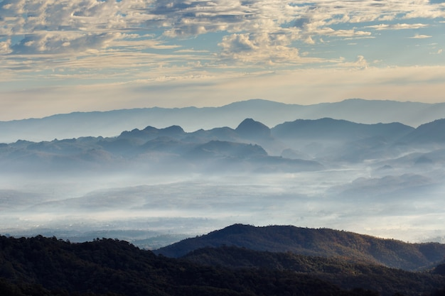 Layer of mountains and mist at sunrise time, landscape at doi luang chiang dao