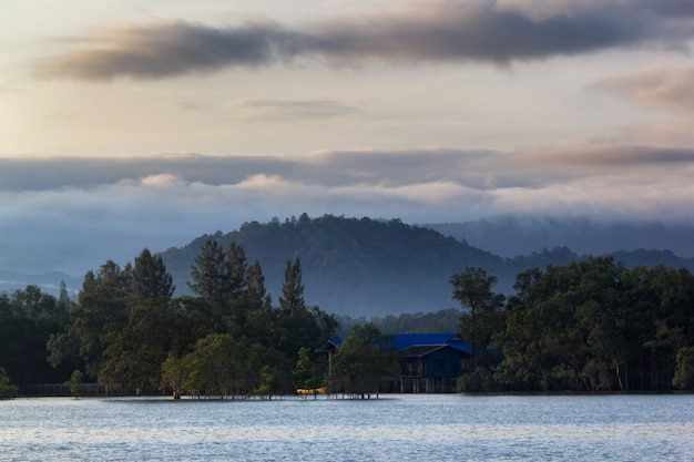 Layer of mountains in the mist at sunrise time, ranong province, thailand