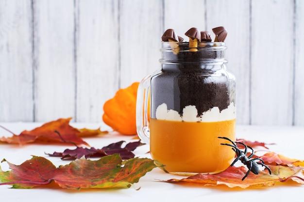 Layered halloween dessert in glass jars