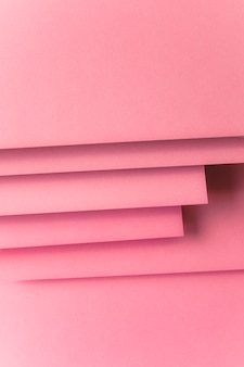 Layered of pink colored card paper backdrop