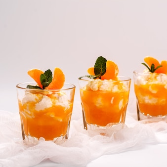 Layered panna cotta with whipped cream and tangerine sauce