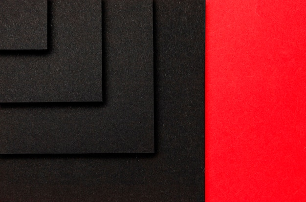 Layers of black squares on red background