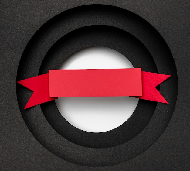 Layers of circular black background and red ribbon