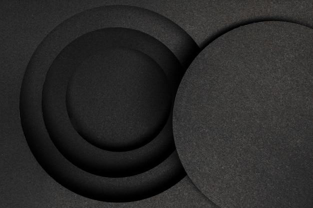 Strati di sfondo nero circolare