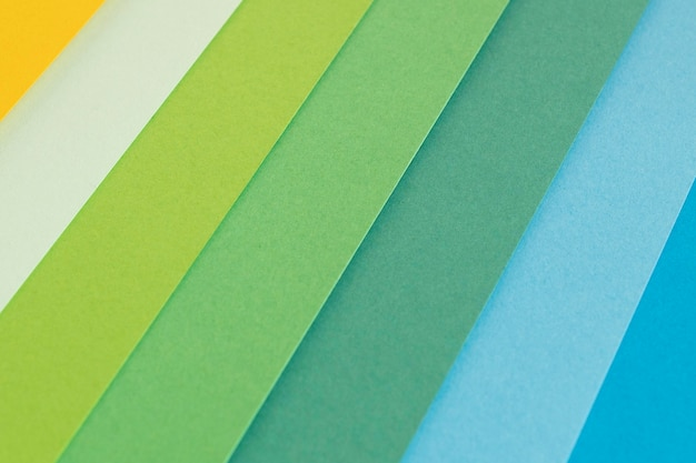 Layers of gradient green colored papers