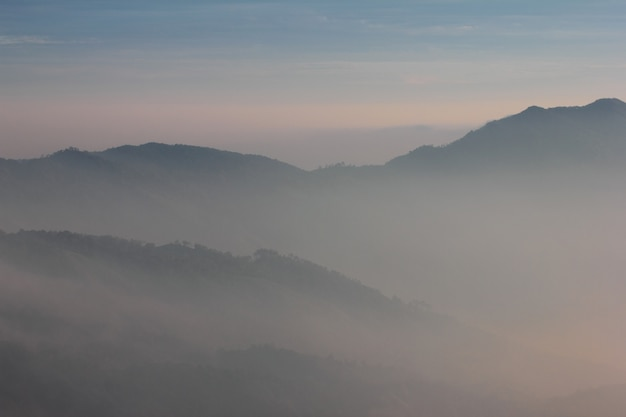 Layers of mountain covered with mist.