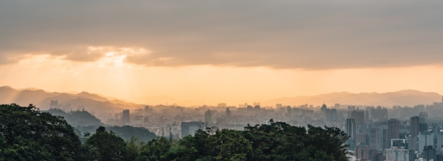 Layers of panorama taipei cityscape and mountains with sunlight when the sun going down.