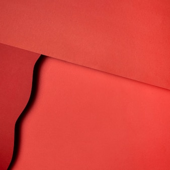 Layers of red torn papers