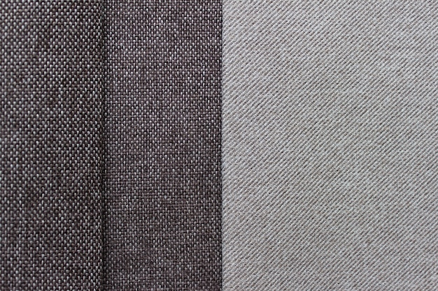 Layers of textured fabric in two lignt and brown colors. photo with copy blank space.