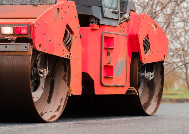 Laying asphalt in the city. road repair concept