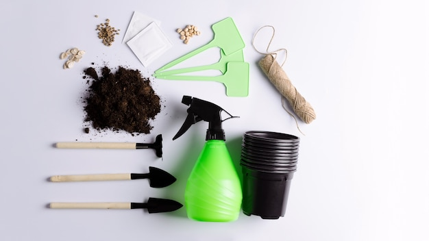 Laying garden tools for planting, growing and caring for plants at home, in a greenhouse.
