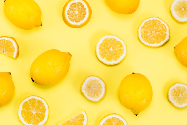Layout of citrus fruits on yellow background