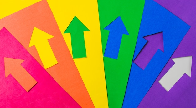 Layout of craft paper arrows in lgbt colors