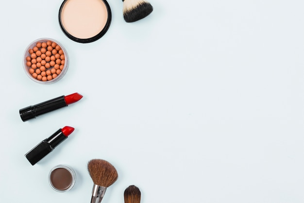 Layout of makeup beauty accessories on light background