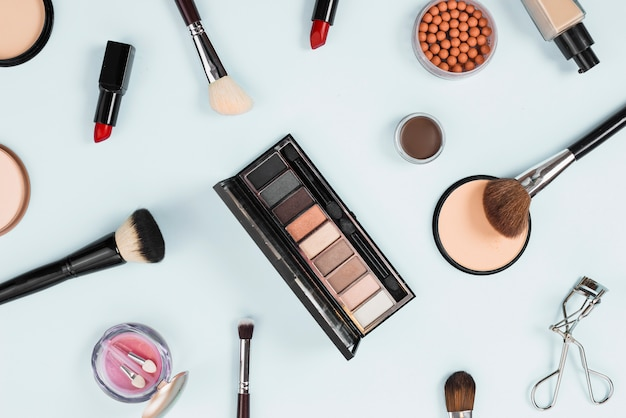 Layout of makeup product on light background