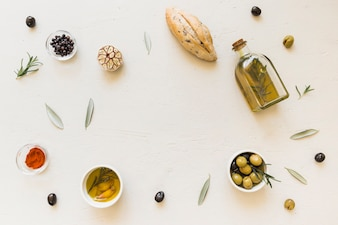 Layout of oil bottle bread olives and spices