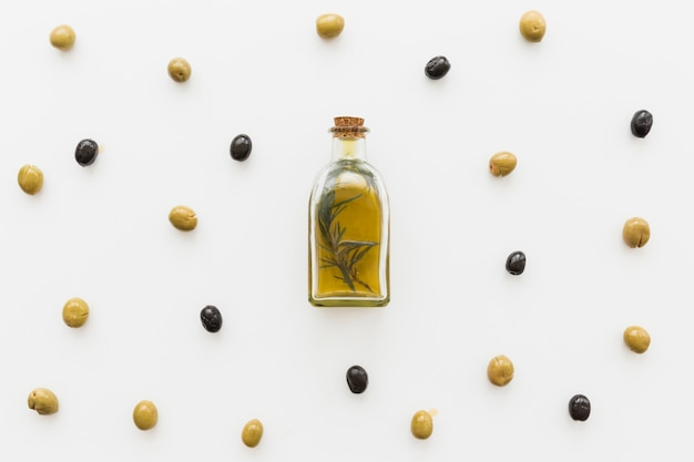 Layout of oil bottle with olives