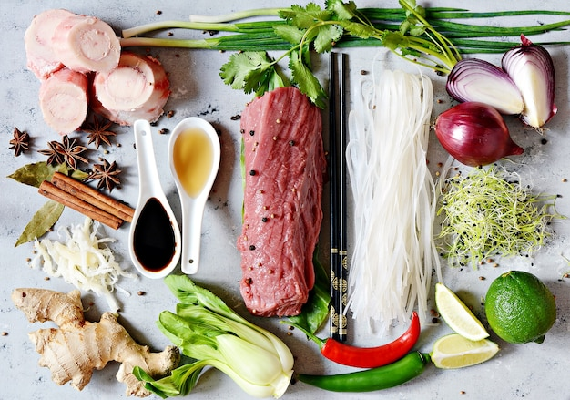 Layout of products on vietnamese pho bo soup on gray