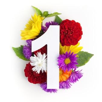 Макет с яркими цветами, листьями и номером один. плоская планировка. вид сверху.