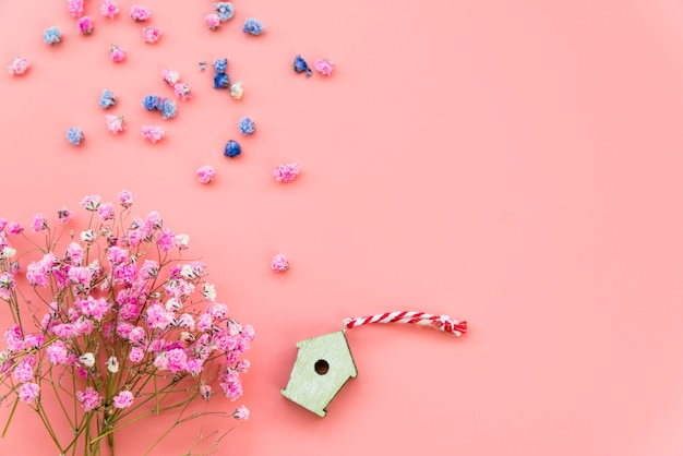 Layout with flowers and wooden box on pink background
