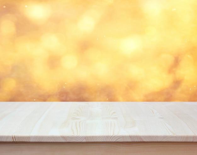 Пустой столешницы на затуманенное золотой фон с боке. layout.