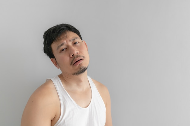 Lazy and messy man in white tank top. concept of poor and problem.