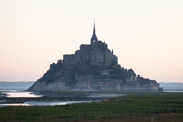 Le mont saint-michel tidal island in beautiful twilight at dusk, normandy, france