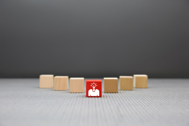 Leader  businessman graphic on wooden block.
