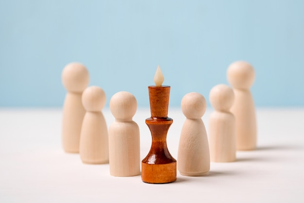 Leader, winner concept. competent supervisor. wooden figures for the king.