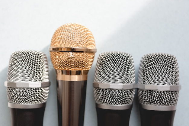 Leadership concept. group of microphones with golden one. freedom to speak up concept.