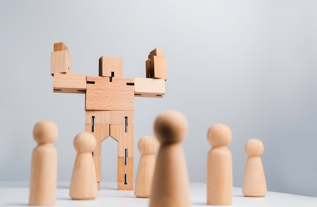 Leadership concept. the leader or influencer, wooden robot strong power gesture standing among wood human, followers on white background, minimal style.