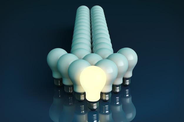 Концепция лидерства. одна светящаяся лампочка, стоящая перед стрелкой лампочки на черном фоне